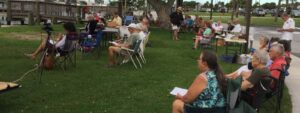 Reach Church meets at Causeway Cove Marina on the beach near the boat rentals. Casual dress and lawn chairs.